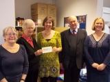 Presenting cheque to Vineyard Church